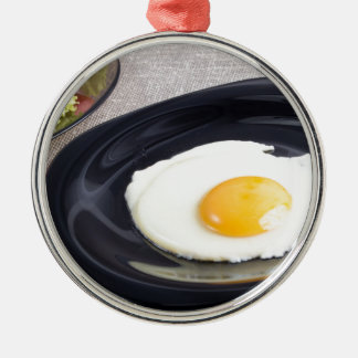 Useful homemade breakfast of fried egg and a salad Silver-Colored round ornament