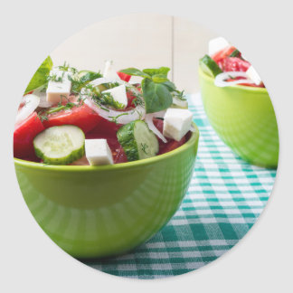 Useful vegetarian food from raw tomatoes, cucumber classic round sticker