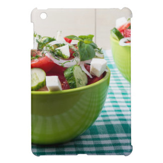 Useful vegetarian food from raw tomatoes, cucumber cover for the iPad mini