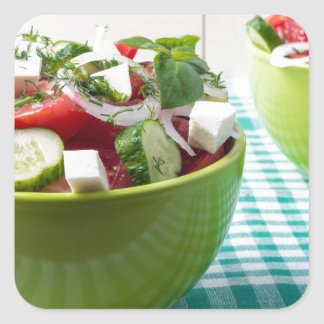 Useful vegetarian food from raw tomatoes, cucumber square sticker