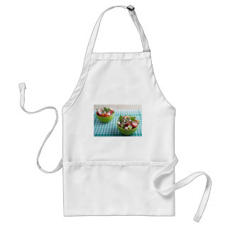 Useful vegetarian food from raw tomatoes, cucumber standard apron