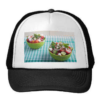 Useful vegetarian food from raw tomatoes, cucumber trucker hat