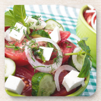 Useful vegetarian salad with raw tomatoes drink coasters
