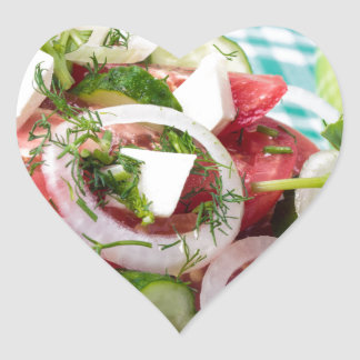 Useful vegetarian salad with raw tomatoes heart sticker