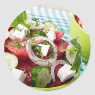 Useful vegetarian salad with raw tomatoes round sticker