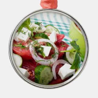 Useful vegetarian salad with raw tomatoes Silver-Colored round ornament