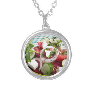Useful vegetarian salad with raw tomatoes silver plated necklace