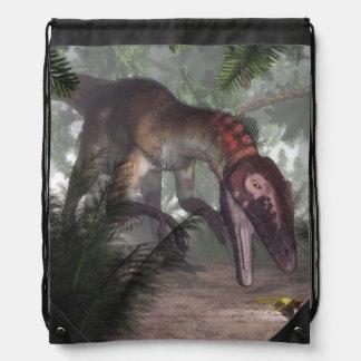 Utahraptor dinosaur hunting a gecko drawstring bag