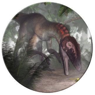 Utahraptor dinosaur hunting a gecko porcelain plates
