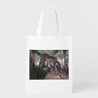 Utahraptor dinosaur hunting a gecko reusable grocery bag
