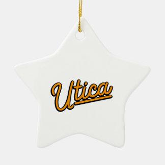 Utica neon light in orange ceramic star ornament