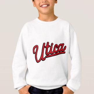 Utica neon light in red sweatshirt