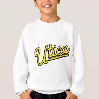 Utica neon light in yellow sweatshirt