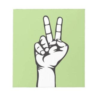 V-sign hand notepad