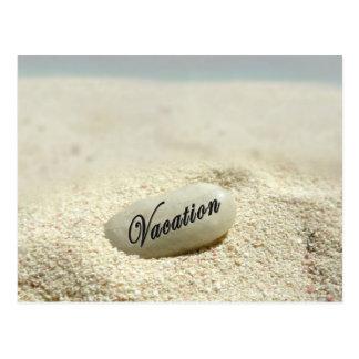 Vacation stone on beach postcard