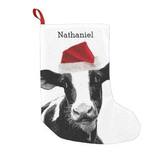 Vache mignonne à Père Noël avec le nom Petite Chaussette De Noël