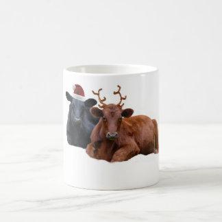 Vaches à vacances de Noël dans le chapeau et des Mug Magique