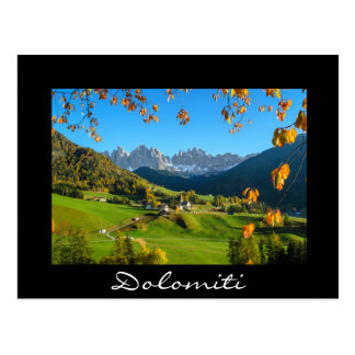 Val di Funes valley with autumn leaves black card