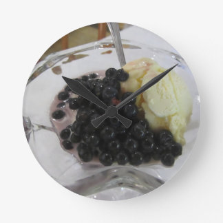 Vanilla ice cream with uncultivated bilberries round clock
