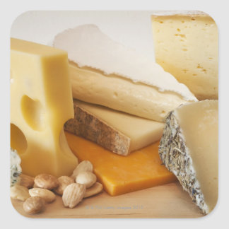 Various cheeses on chopping board stickers