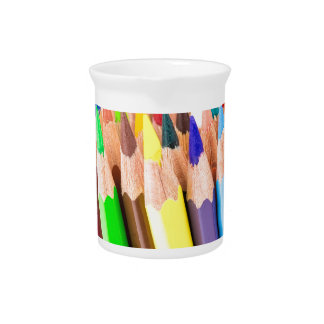 Various colered crayons standing upright drink pitcher