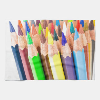 Various colered crayons standing upright kitchen towels