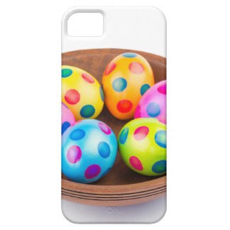Various painted chicken easter eggs in wooden bowl case for the iPhone 5