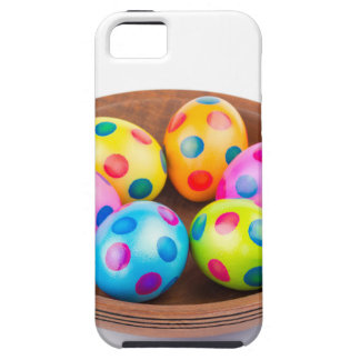 Various painted chicken easter eggs in wooden bowl iPhone 5 cases