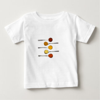 Various seasoning spices on metal spoons baby T-Shirt
