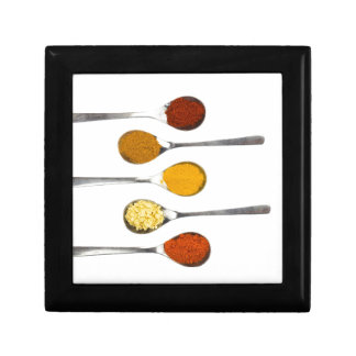 Various seasoning spices on metal spoons gift box