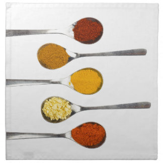 Various seasoning spices on metal spoons napkin