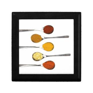 Various seasoning spices on metal spoons trinket boxes