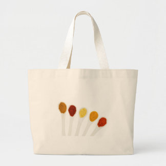 Various seasoning spices on porcelain spoons large tote bag