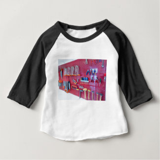 Various tools hanging at wall in high school baby T-Shirt