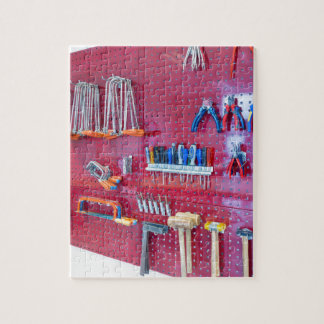 Various tools hanging at wall in high school jigsaw puzzle