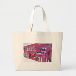 Various tools hanging at wall in high school large tote bag