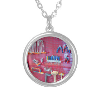 Various tools hanging at wall in high school silver plated necklace
