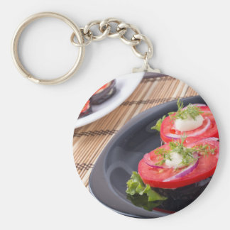 Vegetable dishes of stewed eggplant and fresh red basic round button keychain