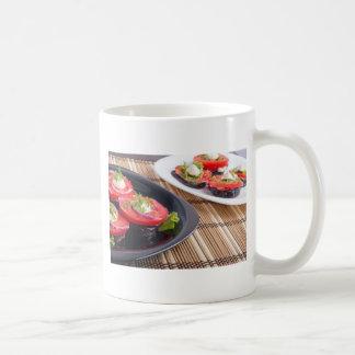 Vegetable dishes of stewed eggplant and fresh red coffee mug