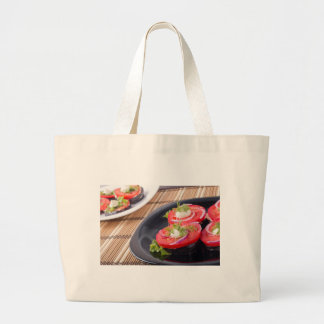 Vegetable dishes of stewed eggplant and fresh red large tote bag