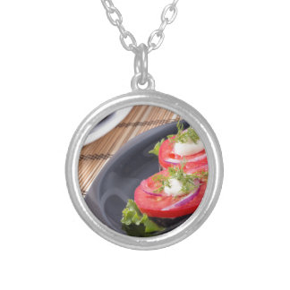 Vegetable dishes of stewed eggplant and fresh red silver plated necklace