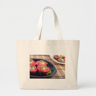 Vegetable dishes of stewed eggplant and tomato large tote bag