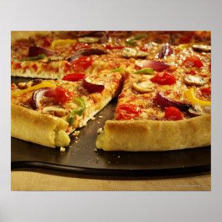Vegetable pizza sliced on black pan on wood poster