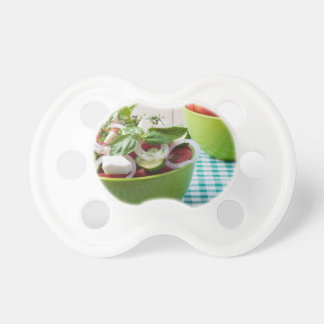 Vegetable vegetarian salad with raw tomato baby pacifier