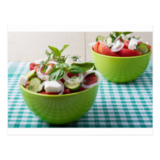 Vegetable vegetarian salad with raw tomato postcard