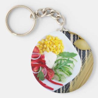 Vegetarian dish of raw vegetables and mozzarella basic round button keychain