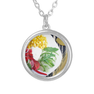 Vegetarian dish of raw vegetables and mozzarella silver plated necklace