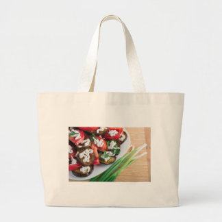 Vegetarian dish of stewed aubergine large tote bag