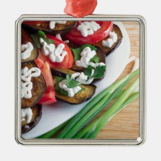 Vegetarian dish of stewed aubergine metal ornament