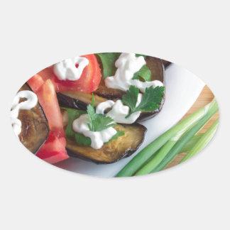 Vegetarian dish of stewed aubergine oval sticker